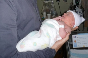 Archie Holding Baby James